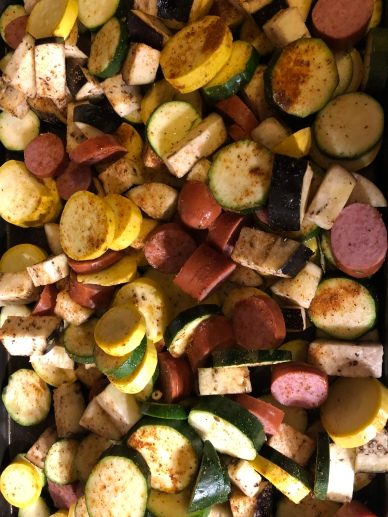 roasted veggies and sausage with seasoning step 1